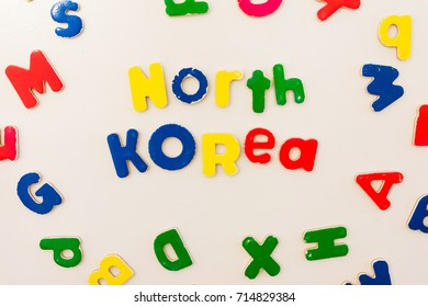 North Korea; Bright colored kids play letters on white refrigerator