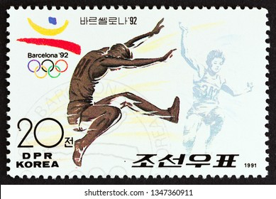 """NORTH KOREA - CIRCA 1991: A stamp printed in North Korea from the """"Summer Olympics 1992, Barcelona"""" issue shows Long Jump, circa 1991."""