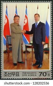 NORTH KOREA - CIRCA 2011: A stamp printed in North Korea shows Kim Jong Il and President Medvedev, Visit of Kim Jong Il to Russia, circa 2011