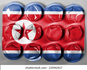 The North Korea flag  painted on tablets or pills