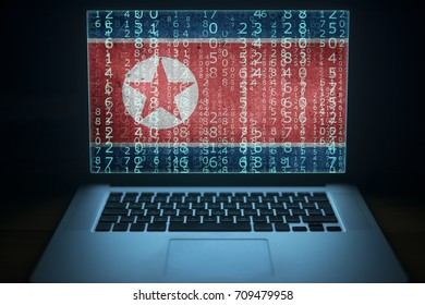 North Korea hacker. Laptop with binary computer code and Korean flag on the screen. Internet and network security.