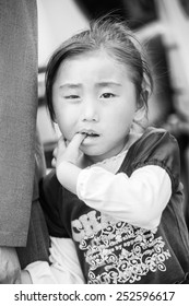 NORTH KOREA - MAY 1, 2012: Korean little girl during the celebration of the International Worker's Day in N.Korea, May 1, 2012. May 1 is a national holiday in 80 countries