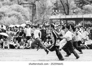 NORTH KOREA - MAY 1, 2012: Korean families jump over a skipping rope during the celebration of the International Worker's Day in N.Korea, May 1, 2012. May 1 is a national holiday in 80 countries
