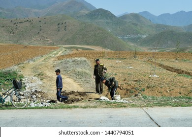 North Korea - May 3, 2019: Roadworks. Soldiers of the North Korean People's Army do road repair work by hand without using equipment and machinery