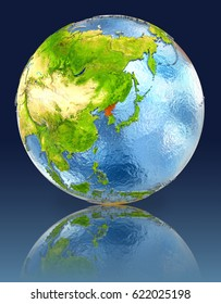 North Korea on globe with reflection. Illustration with detailed planet surface. Elements of this image furnished by NASA.