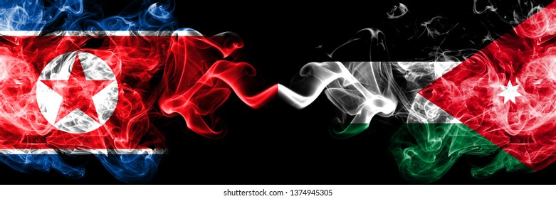 North Korea vs Jordan, Jordanian smoky mystic flags placed side by side. Thick colored silky smoke flags of North Korea and Jordan, Jordanian.