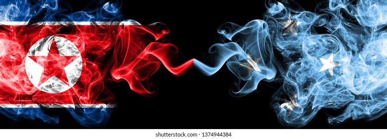 North Korea vs Micronesia, Micronesian smoky mystic flags placed side by side. Thick colored silky smoke flags of North Korea and Micronesia, Micronesian.