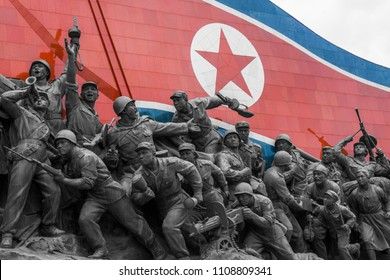 A North Korean flag and several bronze statues are part of the Socialist Revolution Monument, Pyongyang, North Korea, Mai 20, 2018