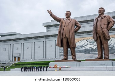 North Korean people bowing in front of Kim Il Sung and Kim Jong Il statues in Mansudae Grand Monument, Pyongyang, North Korea, Mai 20, 2018