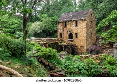 North Little Rock, AR—May 22, 2018; Stone water mill sits among vegetation at JR Pugh Memorial Park. The Old Mill was used to film Gone With The Wind and is on the National Historic Registry.
