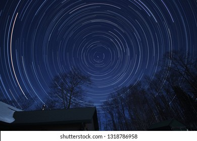 North looking Star Trails with building and trees