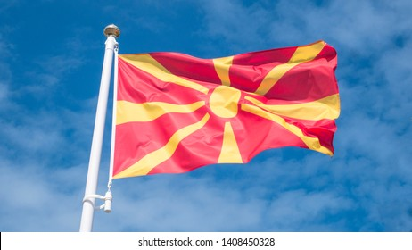 North macedonia flag waving in sunny blue sky.
