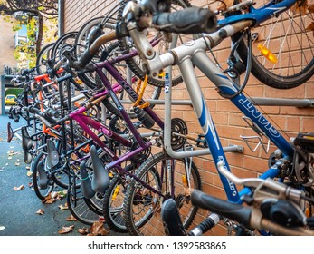 North Melbourne, VIC Australia-June 1st 2018: Bicycles hanging on wall mounted rack of residential apartment units.