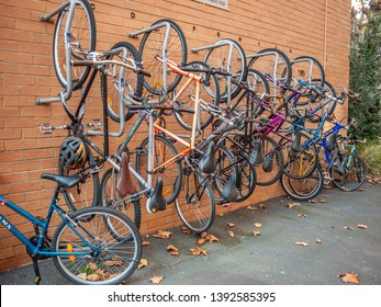 North Melbourne, VIC Australia-June 1st 2018: Bicycles hanging on wall mounted rack in public area of residential apartment units.