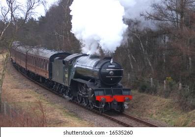 North Norfolk Railway approaching Holt. V2 Green Arrow.
