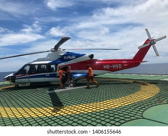 North Pailin Gas field, Gulf of Thailand, Thailand - May 24,2019 : Offshore Transport Helicopter and ground crew, working offshore,The helicopter landed on the rig, sea, refueling station offshore.