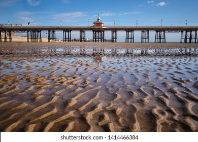 North Pier in Blackpool with the low tide beach in the foreground