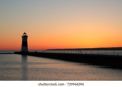 North Pier lighthouse in Erie, PA at sunrise.