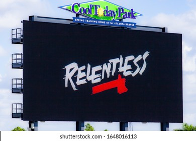 "North Port FL February 17 2020 A close-up shot of the scoreboard at Cool Today Park, the spring training facility for the Atlanta Braves. The scoreboard shows ""Relentless"" with a Braves tomahawk"