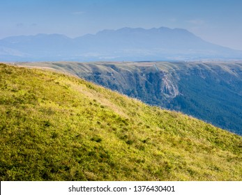 North rim wall of Aso volcanic caldera with Kuju mountains on the background - Aso-Kuju National Park, Kumamoto prefecture, Japan