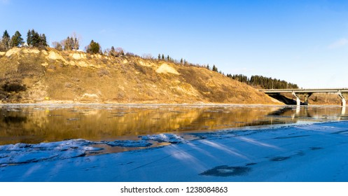 North Saskatchewan river steep bank with reflexion in water фтв вкшаештп шсу