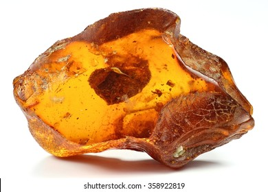 north sea amber with another amber included isolated on white background