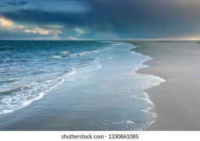North sea beach at cloudy rainy weather, Netherlands