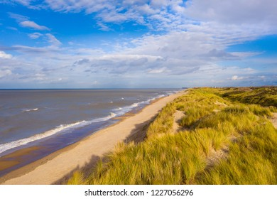 North Sea. Beach with dunes at Belgian North Sea coast. Long sand beach with large sand dunes between De Haan and Oostende. Nature sand dunes in Bredene, Flanders, Belgium.