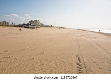 North Sea beach at Noordwijk aan Zee, The Netherlands. Dunes, hotels and beach pavilions in background