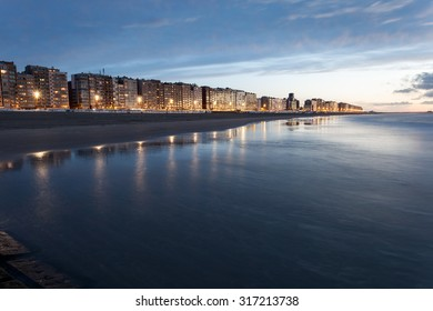 North Sea beach at sunset. Town Blankenberge, West Flanders, Belgium