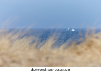 North Sea coast in Denmark with fishing boat