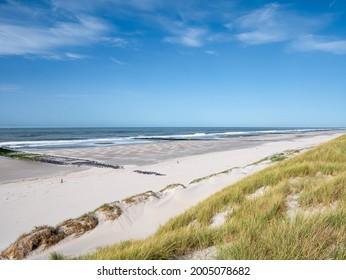 North Sea coast with deserted beach, breakwaters and dunes, West Frisian island Vlieland, Friesland, Netherlands
