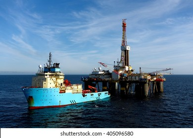 THE NORTH SEA, SCOTLAND - 10 SEPTEMBER 2015. The oilfield supply vessel Maersk Lifter discharges cargo to the semi-submersible drilling rig Transocean Sedco 704.