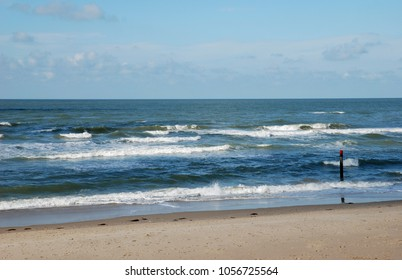 North Sea summer beach in sunset light, on the island Texel, Holland.Europe.