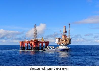 NORTH SEA, UK - 2016 OCTOBER 01. AHTS vessel Island Valiant doing rig move operation for semi submersible rig Borgsten Dolphin next to Dunbar platform.