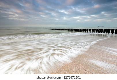 North sea waves on coast in morning, Vlissingen, Netherlands