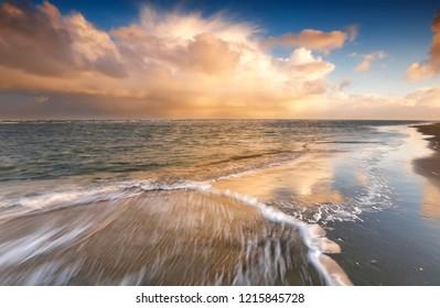 North sea waves at sunrise, Netherlands
