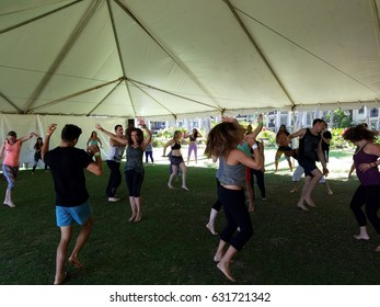 NORTH SHORE, HAWAII - FEBRUARY 26: People dance outdoor under a tent during Ecstatic meditation dancing class at Wanderlust yoga event on the North Shore, Hawaii on February 26, 2017.