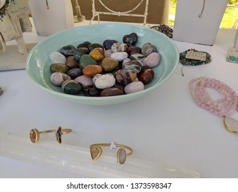 North Shore, Hawaii - March 1, 2019: Stone hearts and Jewelry for sale at Wanderlust Festival.