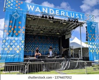 North Shore, Hawaii - March 1, 2019:  Kimberly June preforms on stage during day at outdoor Music festival Wanderlust yoga event on the North Shore, Hawaii.
