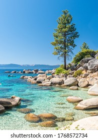 North Shore of Lake Tahoe Secret Harbor with giant granite boulders in clear blue turquoise water on a bright sunny day