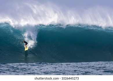 NORTH SHORE, OAHU, HAWAII - JANUARY 25, 2017: An unidentified surfer catches a big wave at Waimea Bay Beach Park located on the North Shore of Oahu.