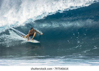 NORTH SHORE, OAHU, HAWAII - JANUARY 11, 2018: An unidentified surfer catches a big wave at the Banzai Pipeline located on the North Shore of Oahu.