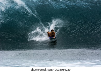 NORTH SHORE, OAHU, HAWAII - MARCH 26, 2017: An unidentified bodyboarder catches a big wave at the Banzai Pipeline located on the North Shore of Oahu.