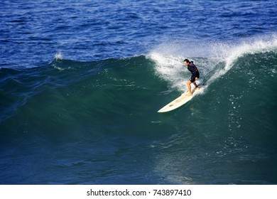 NORTH SHORE, OAHU, HAWAII - OCTOBER 27, 2017: An unidentified man surfs a big wave at Waimea Bay Beach Park located on the North Shore of Oahu.
