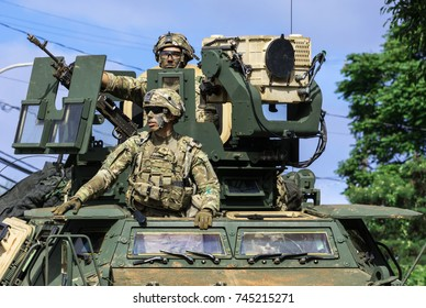 NORTH SHORE, OAHU, HAWAII - OCTOBER 27, 2017: Members of a US Army armored unit proceed down Kamehameha Highway near Waimea Bay Beach Park to an unknown training destination.