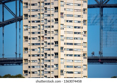 North Sydney apartments in front of the Sydney Harbour Bridge from Balls Head Reserve on a summer day on February 8th 2015.