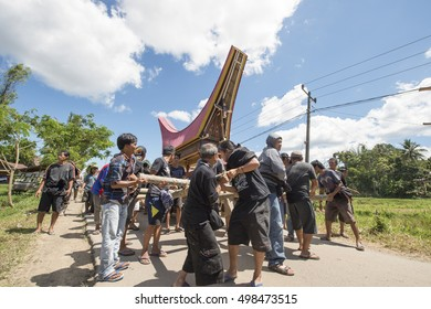 North Toraja, Sulawesi, Indonesia-Aug 30, 2016:Family and relatives parade the coffin to the special burial site called Patane in North Toraja, Indinesia.