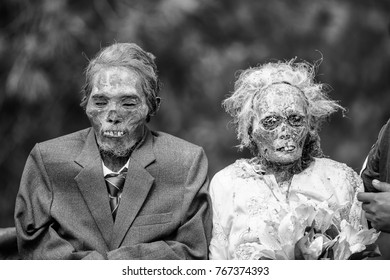 North Toraja, Sulawesi,Indonesia-Aug 27, 2016:Black and white picture of the dead body to bring up to clean off their corpses during the bizarre Ma'nene festival at To'ampalla village, North Toraja.