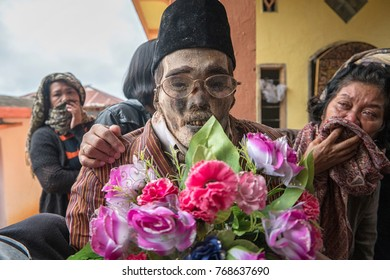 North Toraja, Sulawesi,Indonesia-Aug 27, 2016:The dead body to bring up to clean off their corpses, and dress them as part of the bizarre Ma'nene festival at To'ampalla village, North Toraja.